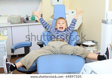 Shot of a happy little boy in a dental surgery. Healthcare, medicine. - stock photo