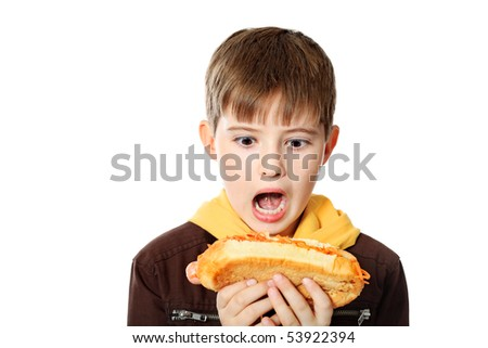 Shot of a hungry boy with a tasty hot dog. Isolated over white background. - stock photo