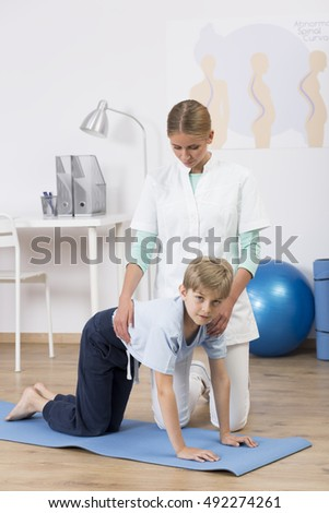 Shot of a little boy doing exercises with his physiotherapist