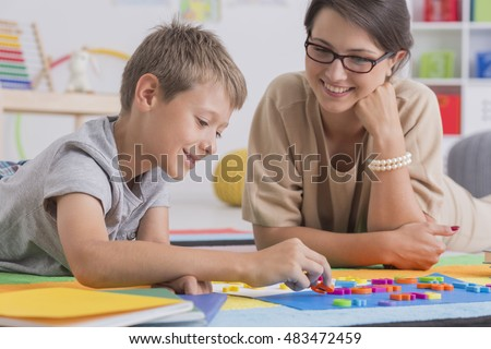 Shot of a little boy having a lesson with his home teacher