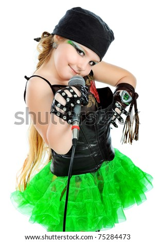 Shot of a little girl dressed as rock musician. Isolated over white background.