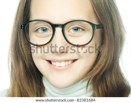 Shot of a little girl in glasses. Isolated on white.