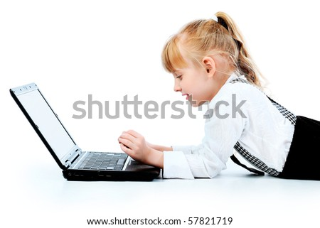 Shot of a little girl lying on a floor with her laptop. Isolated over white background. - stock photo
