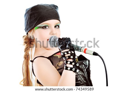 Shot of a little girl singing rock music with a microphone. Isolated over white background. - stock photo