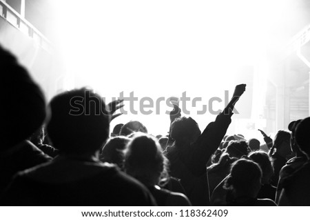 Shot of a live crowd at a concert - stock photo