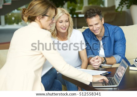 Shot of a middle aged couple consulting with their investment advisor their retirement savings plan.