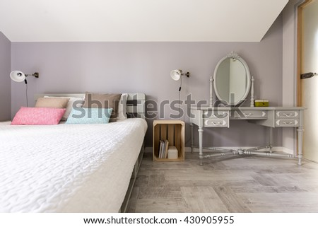 Shot of a modern bedroom with king-size bed