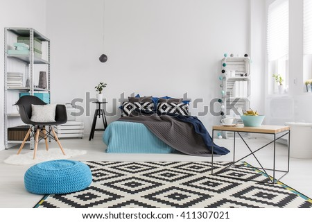Shot of a modern cosy and spacious bedroom - stock photo