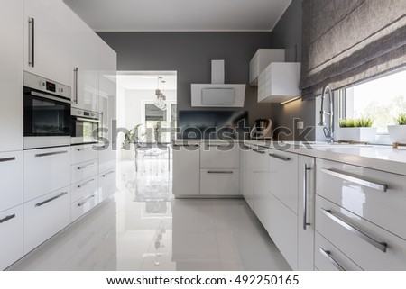 Shot of a modern grey kitchen with white furniture