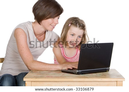 Shot of a Mother and Daughter Using their Laptop - stock photo