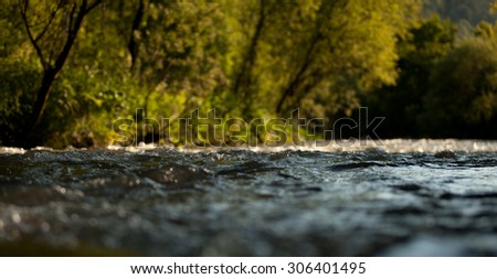 Shot of a mountain water stream from the surface - stock photo