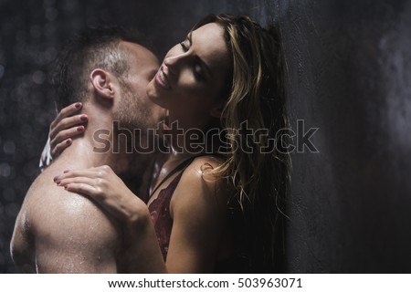 Shot of a naked couple kissing in a shower