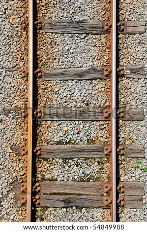 Shot of a part of a railroad track from above - stock photo