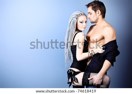 Shot of a passionate loving couple. Over grey background. - stock photo