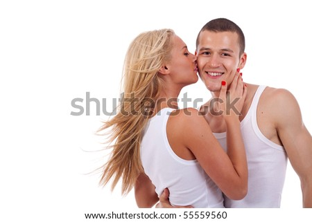 Shot of a passionate loving couple over white background - stock photo