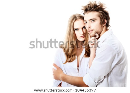 Shot of a passionate young people in love. Isolated over white. - stock photo