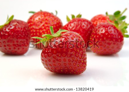 Shot of a pile of fresh strawberries - stock photo
