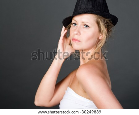 Shot of a Pretty Blonde in Black Hat - stock photo