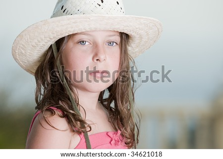 Shot of a Pretty Brown Haired child with White Hat - stock photo