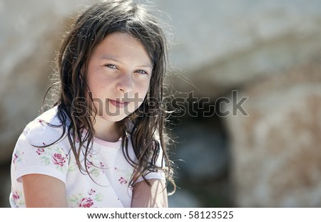 Shot of a Pretty but Messy Brown Haired Girl - stock photo