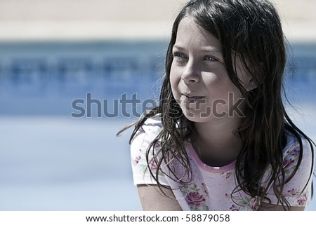 Shot of a Pretty but Messy Brown Haired Girl by the Pool - stock photo