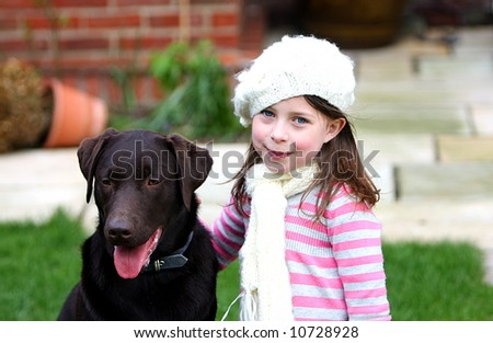 Shot of a Pretty Girl with a Chocolate Labrador - stock photo