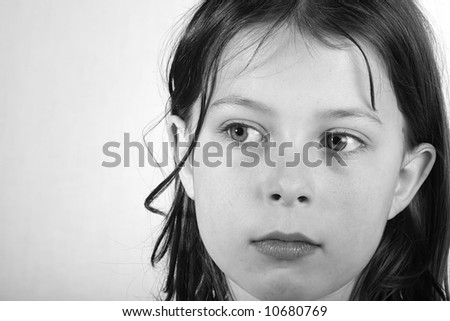 Shot of a pretty seven year old girl looking pensively off camera - stock photo