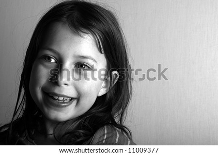 Shot of a pretty young girl smiling and looking off camera - stock photo