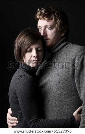 Shot of a 30s Couple Comforting Each Other - stock photo