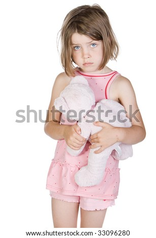 Shot of a Sad Blonde Child Holding her Teddy Bear - stock photo
