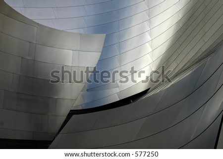 Shot of a segment of wall of the LA opera house designed by Frank Gehry. Excellent for use as a background. Subtle color variations and gradients mixing with reflections. Very crisp. - stock photo