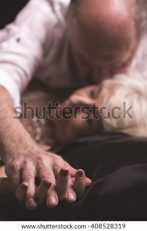Shot of a senior man kissing his wife on the neck