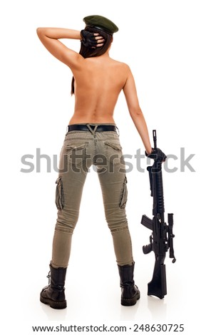 Shot of a sexy military woman posing with guns from back - stock photo