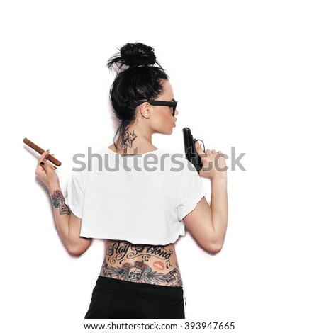Shot of a sexy swag woman posing with gun and cigar.  White background, not isolated - stock photo