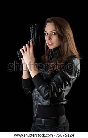 Shot of a sexy woman posing with guns - stock photo