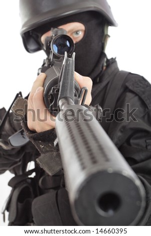 Shot of a soldier holding gun. Uniform conforms to special services.