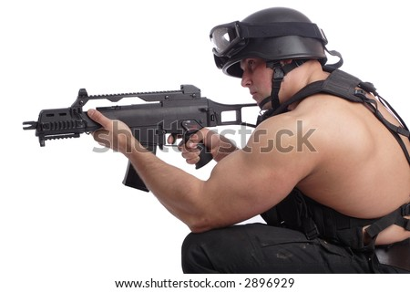 Shot of a soldier holding gun. Uniform conforms to special services(soldiers) of the NATO countries. Shot in studio. Isolated on white. - stock photo