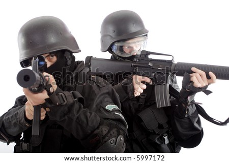 Shot of a soldier holding gun. Uniform conforms to special services(soldiers) of the NATO countries. - stock photo