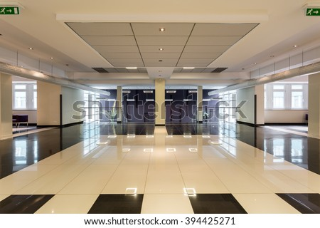 Shot of a spacious modern black and white hall
