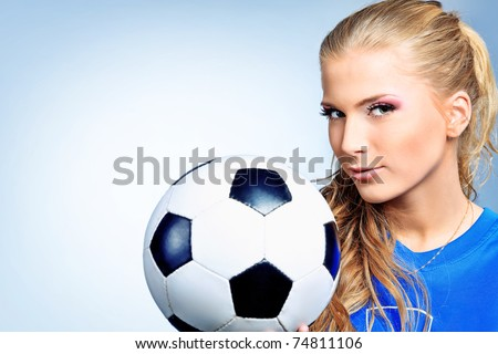 Shot of a sporty young woman with a ball. Active lifestyle, wellness. - stock photo