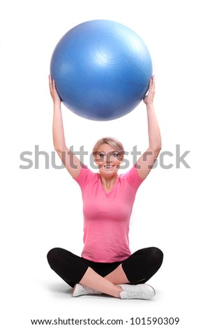 Shot of a sporty young woman with blue ball on a white background.