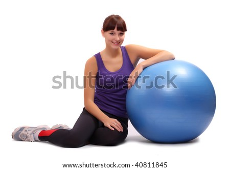 Shot of a sporty young woman with pilates ball. Active lifestyle. - stock photo