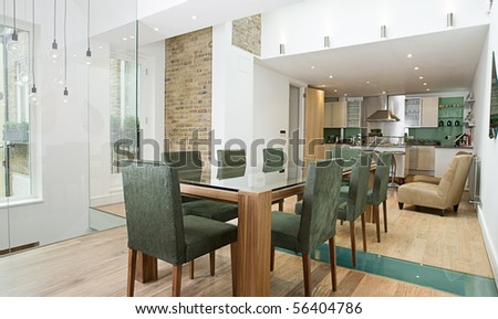 Shot of a Stunning Modern Luxury Interior of Dining Area with Open Plan Kitchen - stock photo