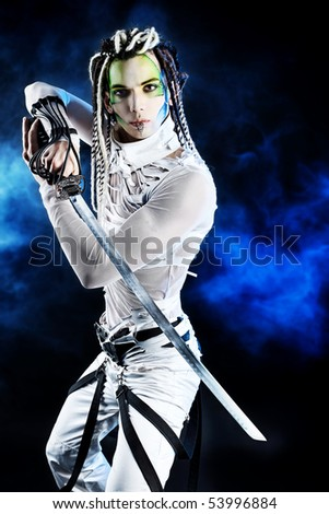 Shot of a stylish male warrior standing with his sword. - stock photo