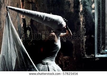 Shot of a twilight girl in white dress. Halloween, horror. - stock photo