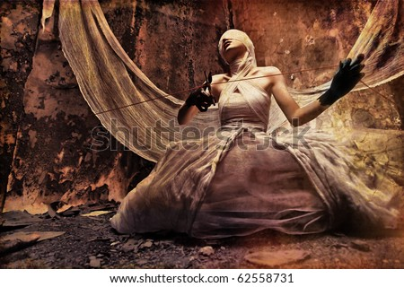 Shot of a twilight girl in white dress. Halloween, horror. - stock photo