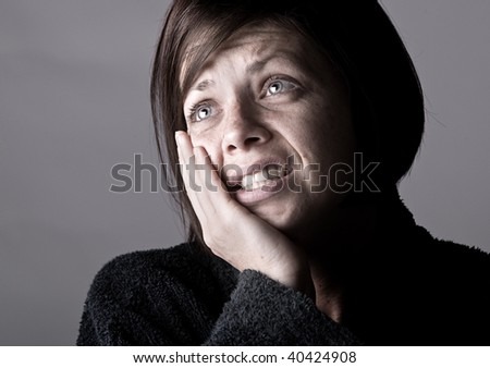 Shot of a Woman with Toothache against Grey - stock photo