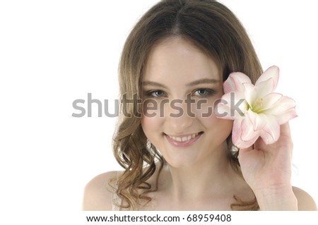 Shot of a young beautiful woman with a lily flower