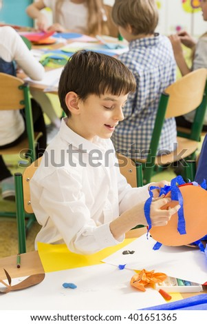 Shot of a young boy focused during his art class