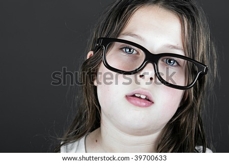Shot of a Young Brown Haired Geek with Glasses - stock photo